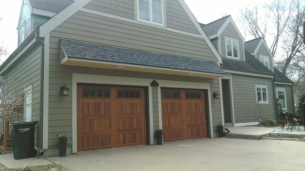 Outside Of Large Home With New Garage Door